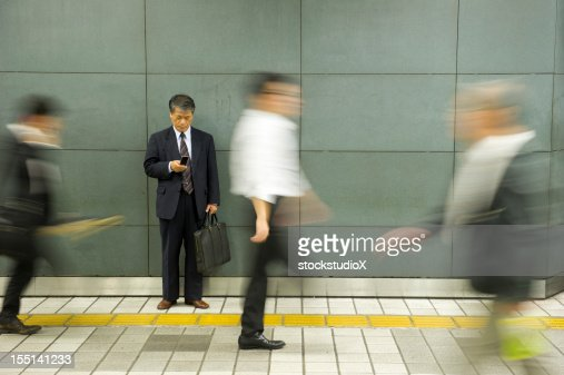 Businessman in focus with the rest of the scene in motion