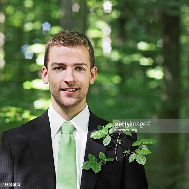 Businessman in forest, close up