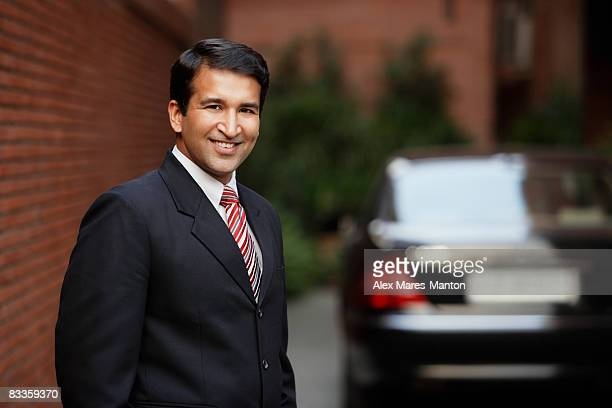 businessman in front of car