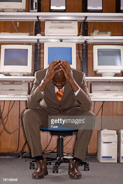 Businessman in Front of Computers