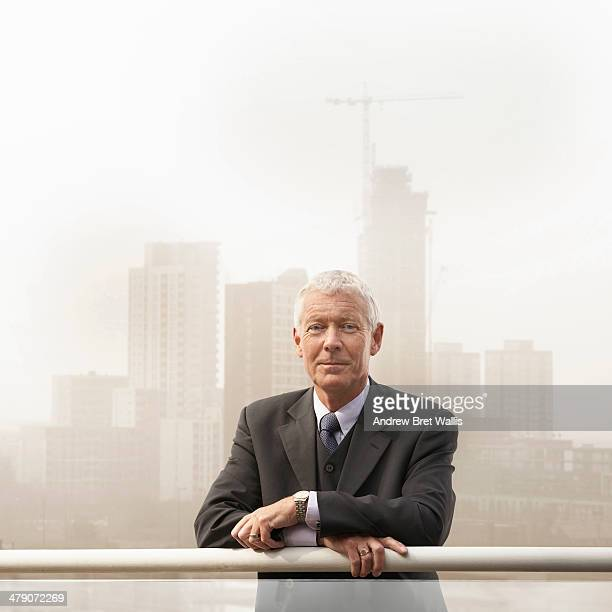 Businessman in front of new building development