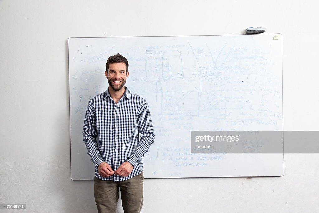 Businessman in front of whiteboard : Stock Photo