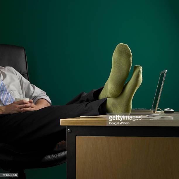 Businessman in green socks.