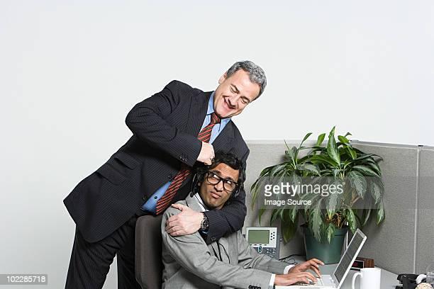 Businessman in headlock
