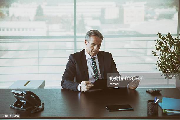 Businessman in his office reading a contract