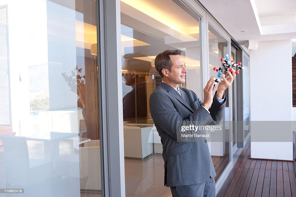 Businessman in  hotel lobby with  molecule model : Stock Photo