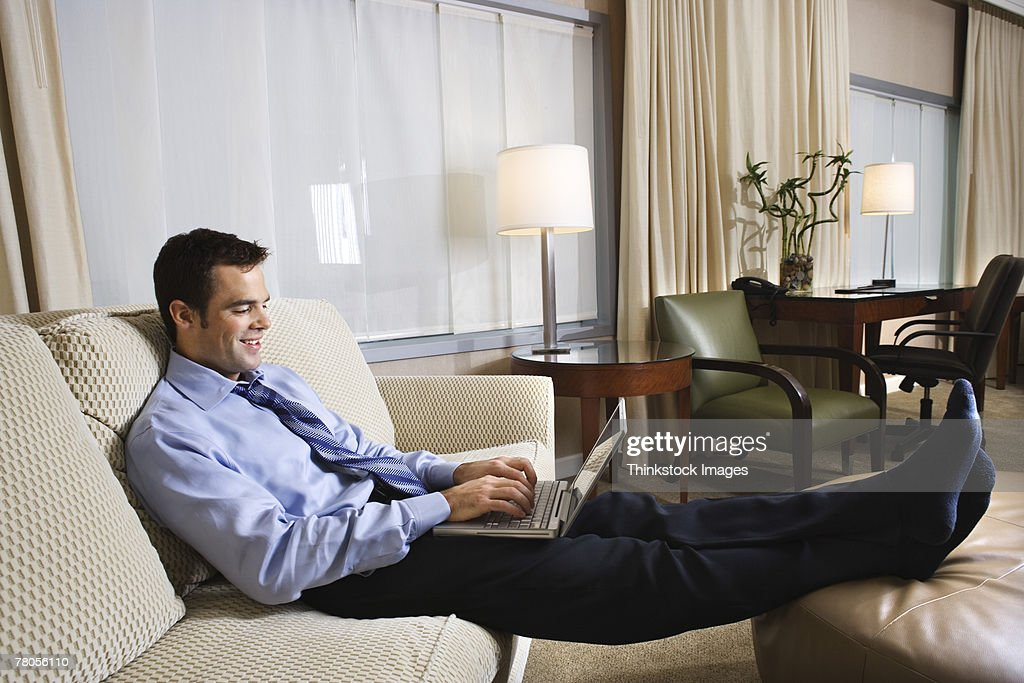 Businessman in hotel room with laptop