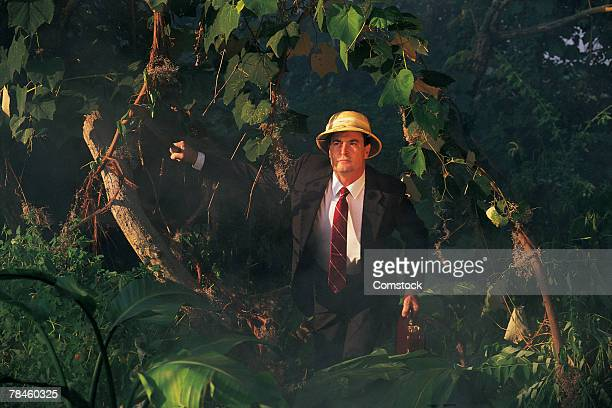Businessman in jungle