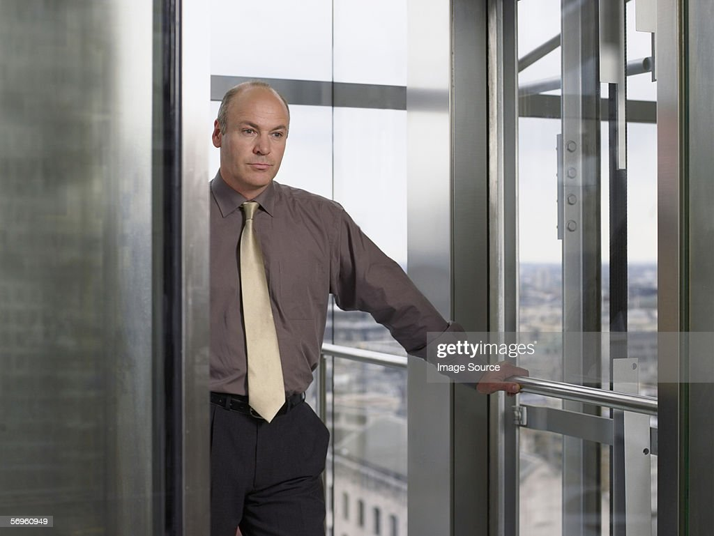 Businessman in lift : Stock Photo