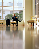 Businessman in lobby with cellphone