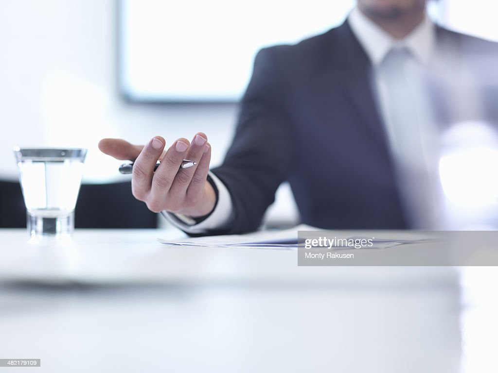 Businessman in meeting, close up : Stock Photo