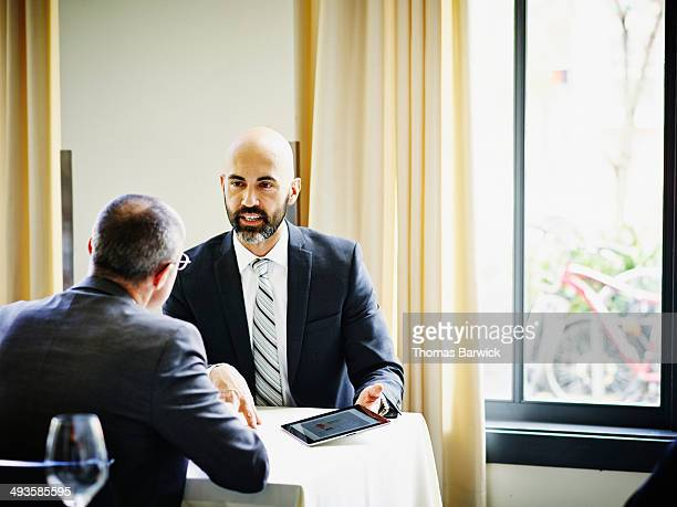 Businessman in meeting with client in restaurant