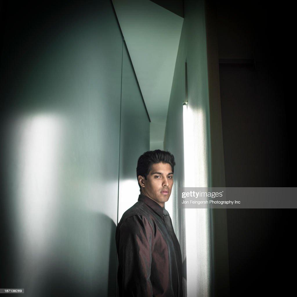 Businessman in narrow hallway