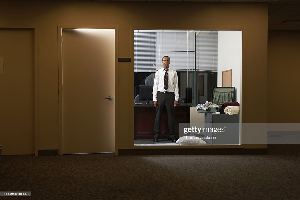 Businessman in office late at night : Stock Photo