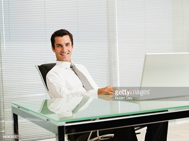 Businessman in office with computer