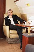 Businessman in private airplane