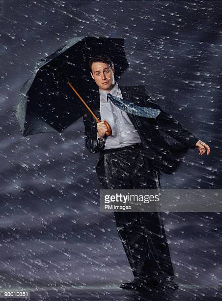 Businessman in rain and wind