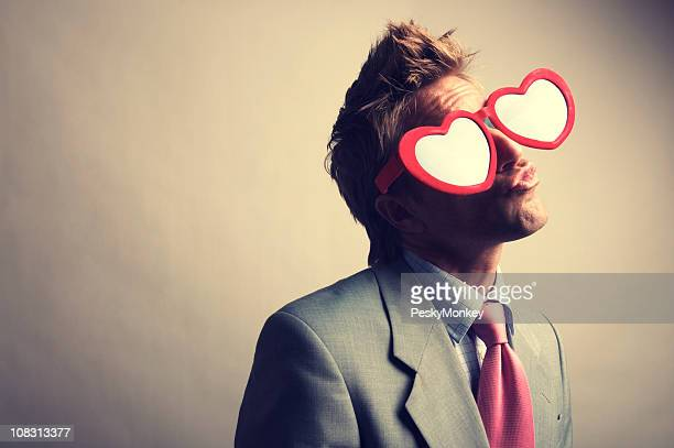 Businessman in Red Heart Glasses Kissing with Puckered Lips