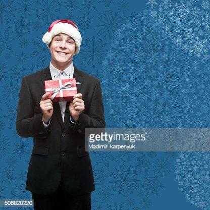businessman in santa hat holding gift : Stock Photo