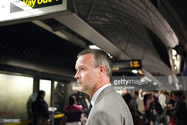 Businessman in subway station