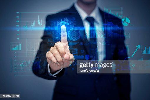 Businessman in suit working with digital virtual screen : Stockfoto
