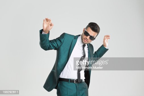 Businessman in sunglasses dancing