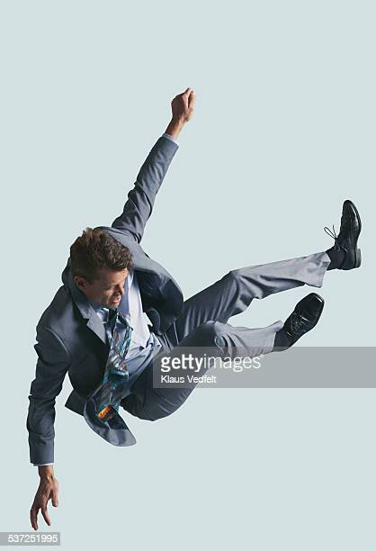 Businessman in the air, falling down