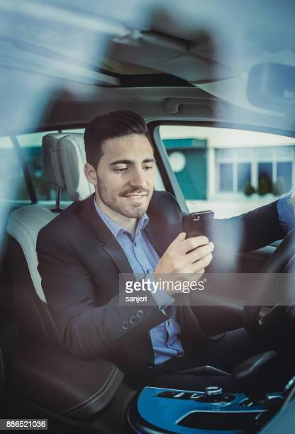 Businessman in the Car Using Smart Phone