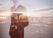 Double exposure image of businessman in the city.