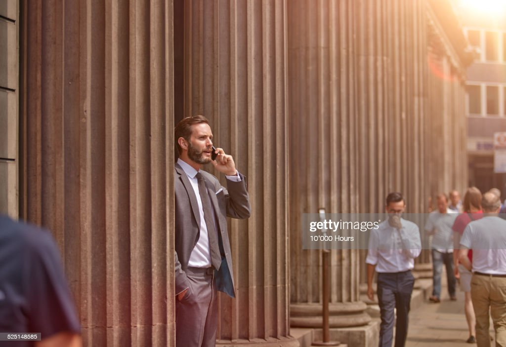 A businessman in the city talking on phone