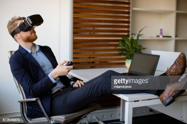 Businessman in the office using VR headset