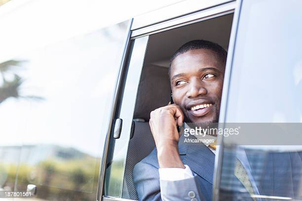 Businessman in the taxi on his cell phone