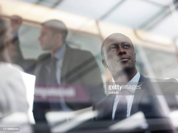 businessman in train, looking out of window