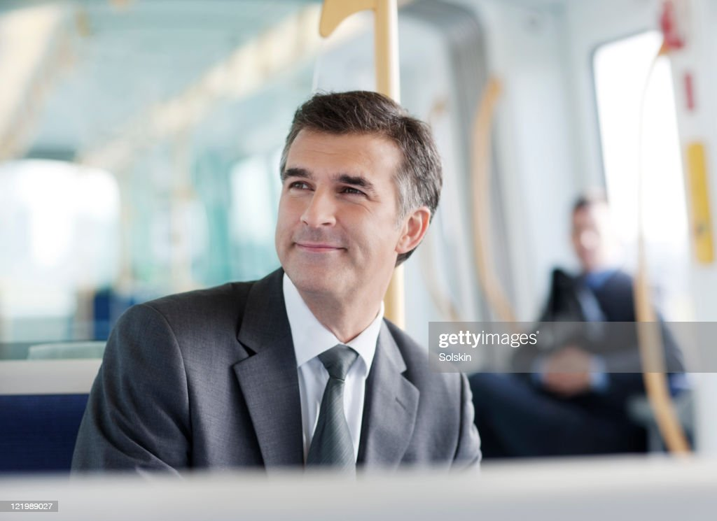 Businessman in train : Stock Photo