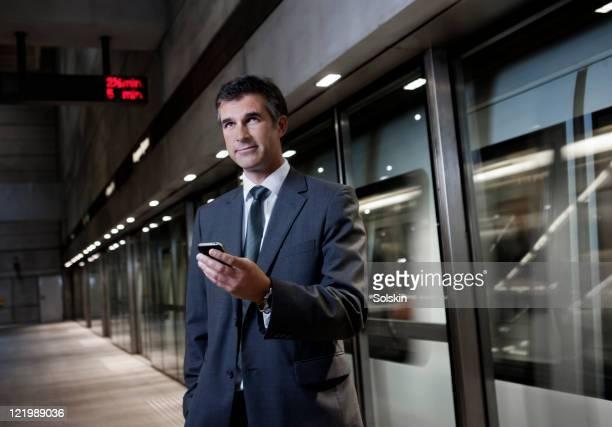 Businessman in underground trainstation
