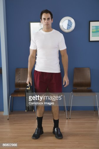 Businessman in underwear in office waiting room : Stock Photo