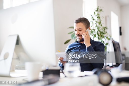 Businessman in wheelchair at the desk in his office. : Foto de stock