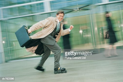 Businessman Inline Skating on the Pavement