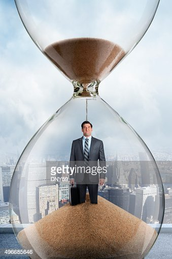Businessman Inside An Hourglass