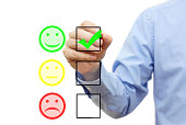 businessman is choosing smile on checklist, customer satisfaction concept