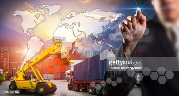 Businessman is pressing button on touch screen interface in front for Logistic Import Export background, Internet of Things concept, or instant shipping, Online goods orders worldwide
