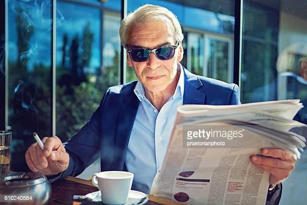 Businessman is reading newspaper
