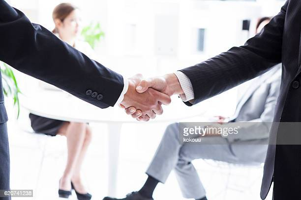 Businessman is shaking hands with trading partners
