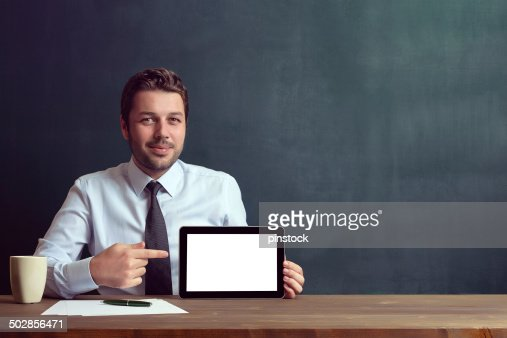 Businessman is showing digital tablet.