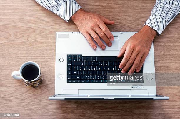 Businessman is  typing on laptop
