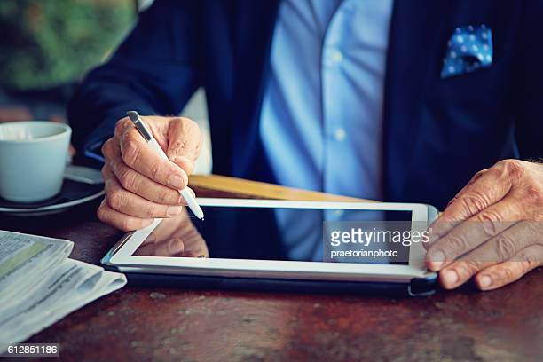 Businessman is working using his tablet