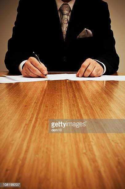 Businessman is writing a document