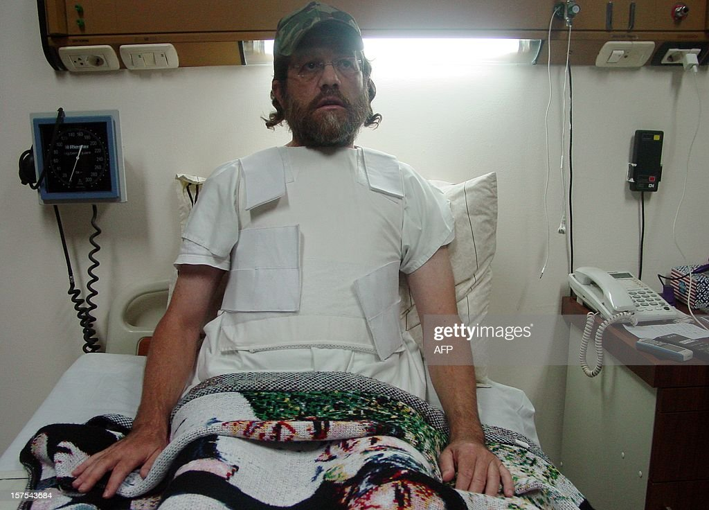 U.S. businessman Jacob Ostreicher lies on his bed at hospital wearing a bullet-proof vest in Santa Cruz, Bolivia, on December 4, 2012. Ostreicher, imprisoned without trial since June 2011 on charges of money laundering for the drug trafficking, said days ago having been extorted by judges, prosecutors and agents of the Bolivian government in terms to get his release.