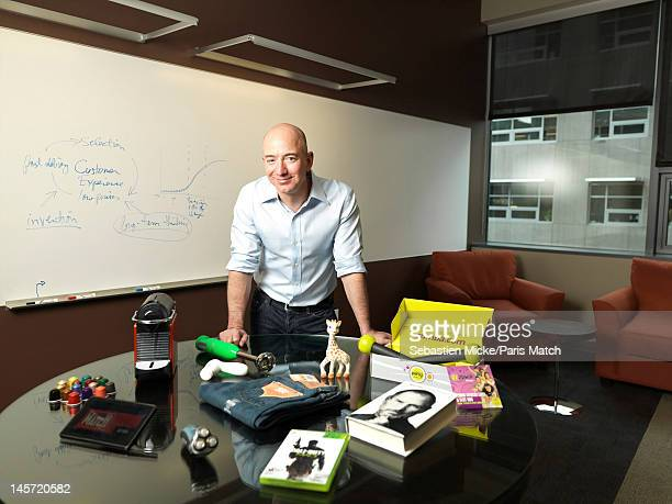 Businessman Jeff Bezos photographed at Amazon headquarters for Paris Match on February 13 2012 in Seattle Washington On the table are the top ten...