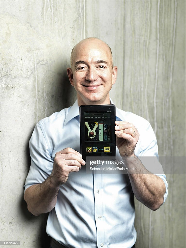Businessman <a gi-track='captionPersonalityLinkClicked' href=/galleries/search?phrase=Jeff+Bezos&family=editorial&specificpeople=217573 ng-click='$event.stopPropagation()'>Jeff Bezos</a> presenting the Kindle, photographed at Amazon headquarters for Paris Match on February 13, 2012 in Seattle, Washington.